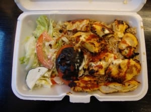 Chicken kebab over rice