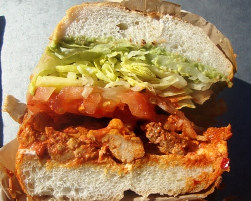 sandwich came on a soft Portuguese roll that had chunks of marinated ...